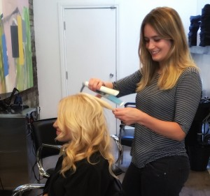 Victoria creating beach waves with a flat iron.